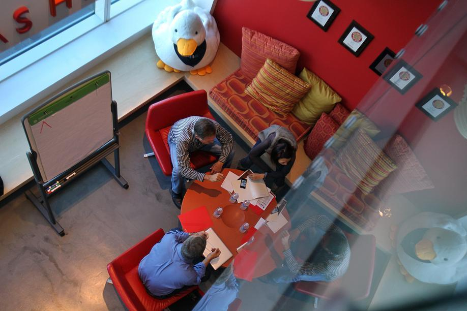 Workers at Digitas's Boston office use a collaborative lounge for meetings.